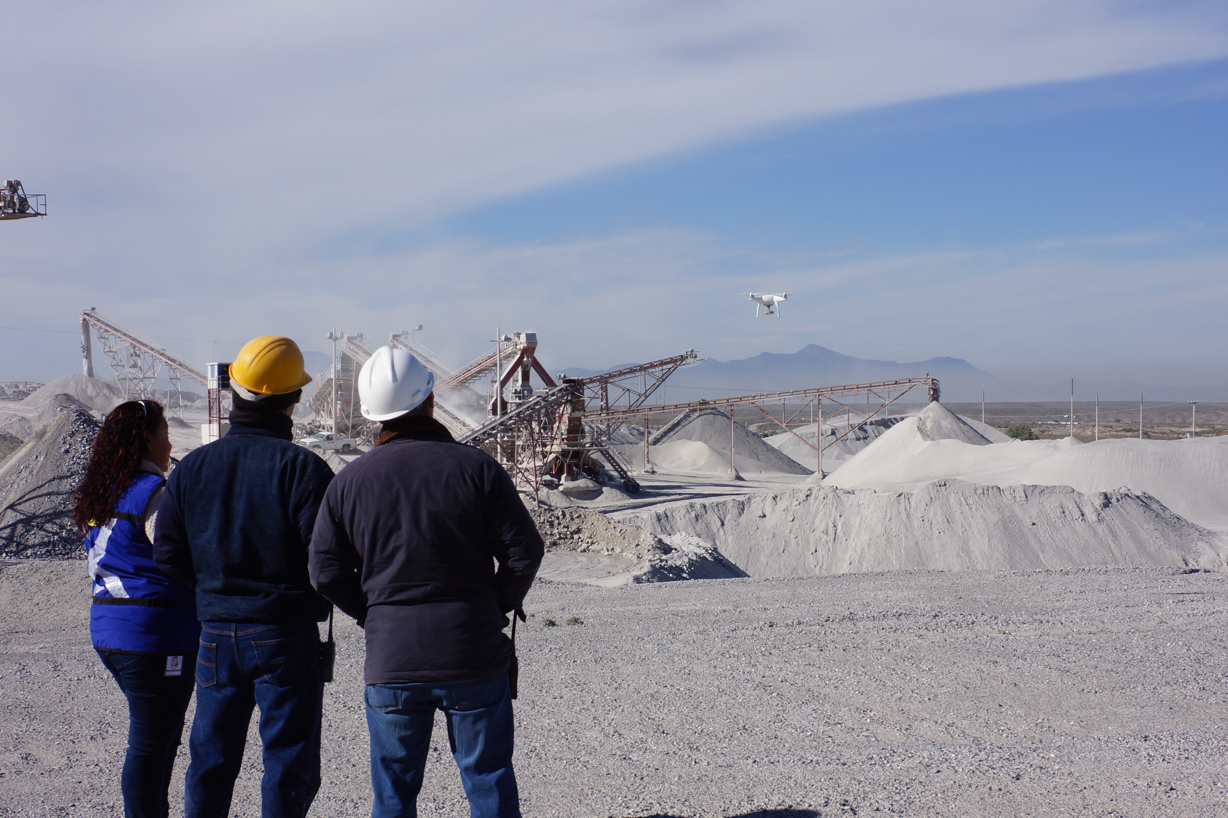 Industrial workers inspect stockpiles